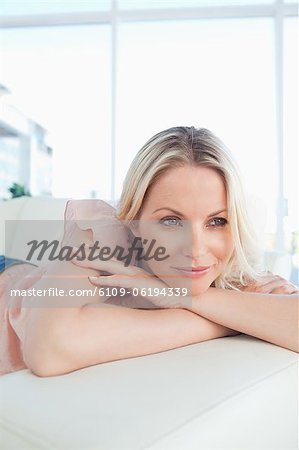 Caucasian woman lying on her sofa Stock Photo - Premium Royalty-Free, Image code: 6109-06194339