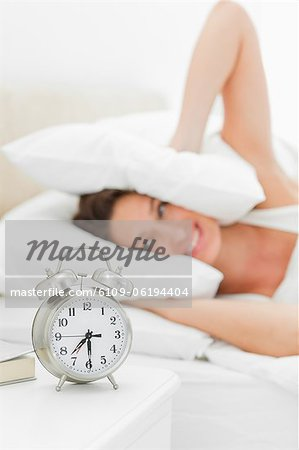 Alarms clock is ringing loudly Stock Photo - Premium Royalty-Free, Image code: 6109-06194404