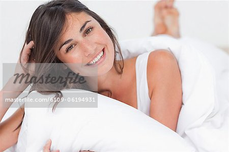 Portrait of a beaming woman in her bed Stock Photo - Premium Royalty-Free, Image code: 6109-06194931