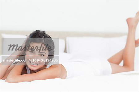 Portrait of a beautiful woman in her bed Stock Photo - Premium Royalty-Free, Image code: 6109-06194935