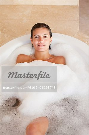 Woman relaxing in the tub Stock Photo - Premium Royalty-Free, Image code: 6109-06195745