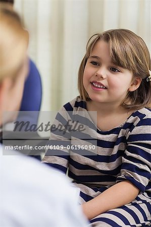 Cute girl sitting in a waiting room Stock Photo - Premium Royalty-Free, Image code: 6109-06196090