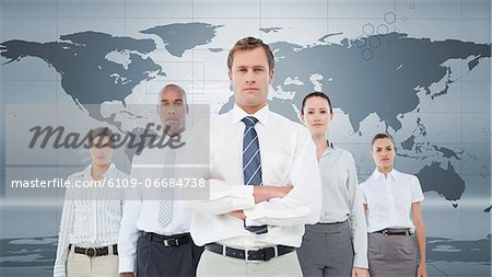 Serious business team standing Stock Photo - Premium Royalty-Free, Image code: 6109-06684738