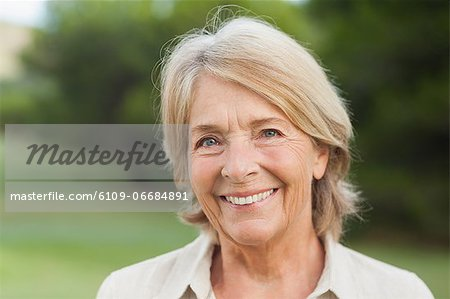 Smiling older woman Stock Photo - Premium Royalty-Free, Image code: 6109-06684891