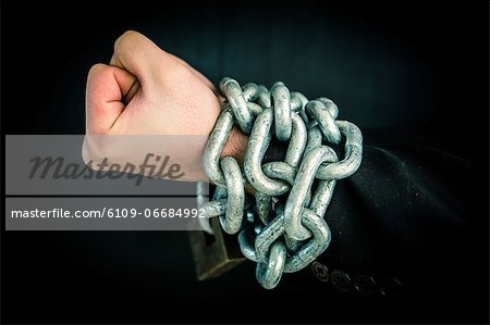 Hand wrapped in chain and lock Stock Photo - Premium Royalty-Free, Image code: 6109-06684992