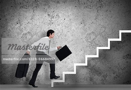 Businessman climbing the stairs to the top Stock Photo - Premium Royalty-Free, Image code: 6109-06684997