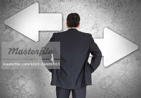 Businessman choosing which direction to go Stock Photo - Premium Royalty-Free, Image code: 6109-06685003