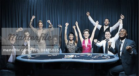 Attractive group cheering at the casino Stock Photo - Premium Royalty-Free, Image code: 6109-06685005