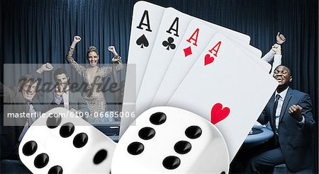 Attractive group cheering at the casino with digital cards and dice Stock Photo - Premium Royalty-Free, Image code: 6109-06685006