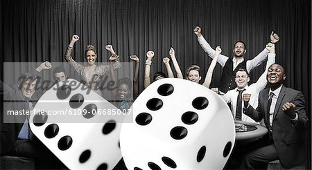 Attractive group cheering at the casino with digital dice Stock Photo - Premium Royalty-Free, Image code: 6109-06685007