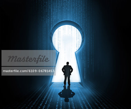 Businessman standing at the keyhole door showing light Stock Photo - Premium Royalty-Free, Image code: 6109-06781453