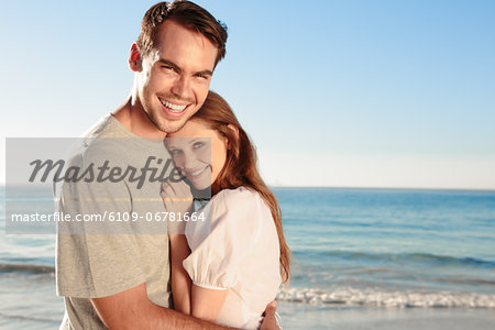 Cheerful couple relaxing on the beach during  summer Stock Photo - Premium Royalty-Free, Image code: 6109-06781664