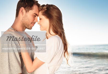 Romantic couple relaxing and embracing on the beach Stock Photo - Premium Royalty-Free, Image code: 6109-06781667