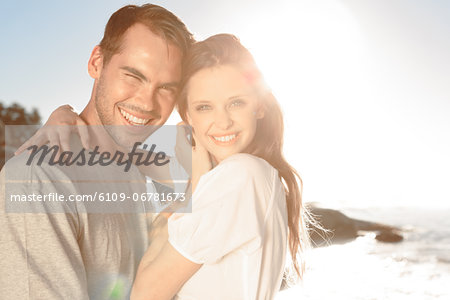Cheerful couple embracing on the beach Stock Photo - Premium Royalty-Free, Image code: 6109-06781673