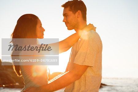 Young couple embracing each other on the beach Stock Photo - Premium Royalty-Free, Image code: 6109-06781689