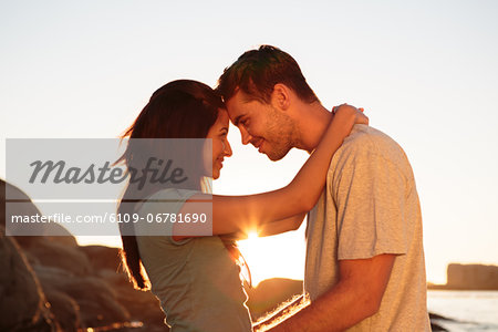 Couple embracing each other on the beach Stock Photo - Premium Royalty-Free, Image code: 6109-06781690