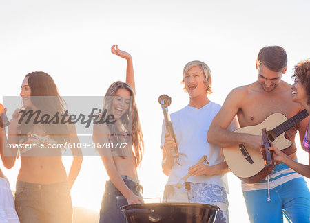 Group of friends having fun together on the beach Stock Photo - Premium Royalty-Free, Image code: 6109-06781772