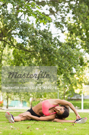 Full length of a toned and flexible woman doing stretching exercise in the park Stock Photo - Premium Royalty-Free, Image code: 6109-07498029