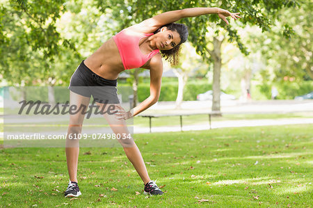 Full length of a toned and flexible woman doing stretching exercise in the park Stock Photo - Premium Royalty-Free, Image code: 6109-07498034