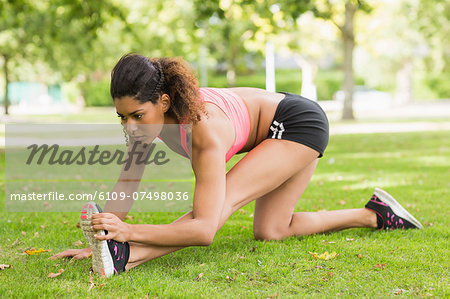Full length of a toned and flexible woman doing stretching exercise in the park Stock Photo - Premium Royalty-Free, Image code: 6109-07498036