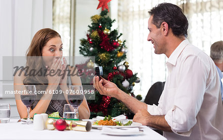 Man proposing a surprised woman in the restaurant Stock Photo - Premium Royalty-Free, Image code: 6109-07600958