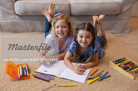 Full length portrait of siblings drawing in living room Stock Photo - Premium Royalty-Free, Image code: 6109-07601495
