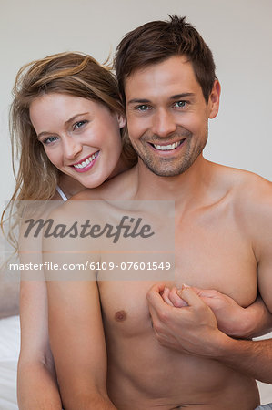 Portrait of loving relaxed couple in bedroom Stock Photo - Premium Royalty-Free, Image code: 6109-07601549