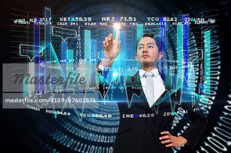 Asian businessman pointing to data interface Stock Photo - Premium Royalty-Free, Image code: 6109-07601576