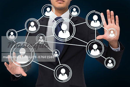 Businessman touching profile interface Stock Photo - Premium Royalty-Free, Image code: 6109-07601580