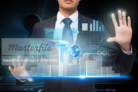Businessman touching interface with graphics Stock Photo - Premium Royalty-Free, Image code: 6109-07601582
