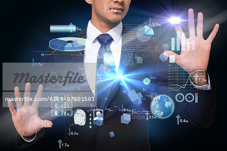 Businessman touching interface with graphics Stock Photo - Premium Royalty-Free, Image code: 6109-07601583
