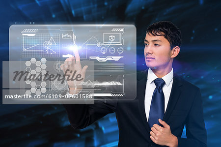 Serious businessman touching interface Stock Photo - Premium Royalty-Free, Image code: 6109-07601588