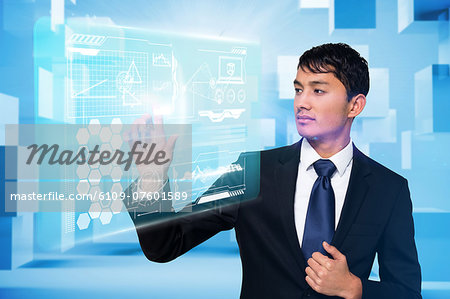 Serious businessman touching interface Stock Photo - Premium Royalty-Free, Image code: 6109-07601589