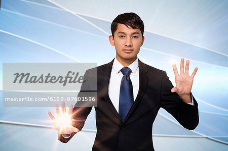 Serious businessman touching lights Stock Photo - Premium Royalty-Free, Image code: 6109-07601596