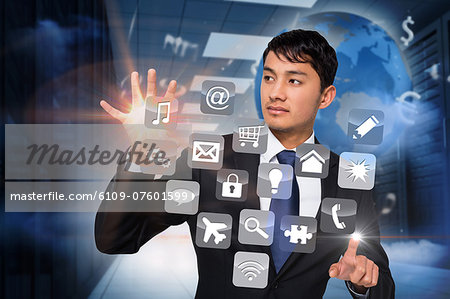 Asian businessman touching app interface Stock Photo - Premium Royalty-Free, Image code: 6109-07601599