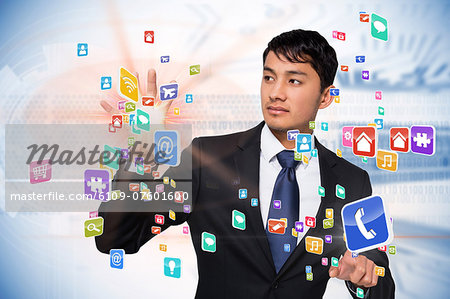 Asian businessman touching app interface Stock Photo - Premium Royalty-Free, Image code: 6109-07601600