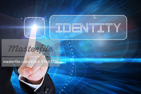 Businesswomans finger touching Identity button Stock Photo - Premium Royalty-Free, Image code: 6109-07601715