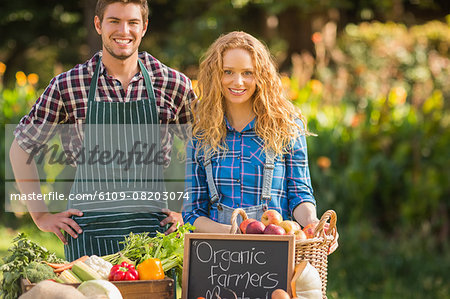 Couple selling organic vegetables at market Stock Photo - Premium Royalty-Free, Image code: 6109-08203074