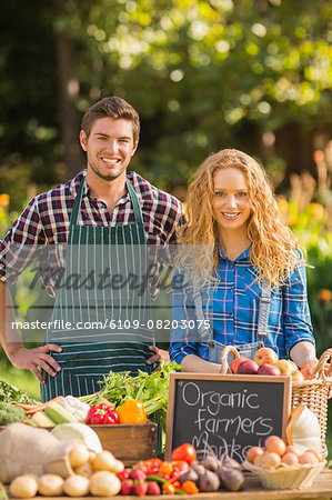 Couple selling organic vegetables at market Stock Photo - Premium Royalty-Free, Image code: 6109-08203075