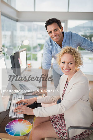 Smiling casual business team working together Stock Photo - Premium Royalty-Free, Image code: 6109-08203183