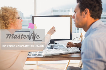 Smiling casual business team working together Stock Photo - Premium Royalty-Free, Image code: 6109-08203186