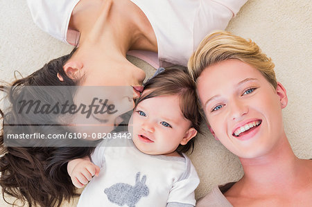 Lesbian couple lying with their baby girl Stock Photo - Premium Royalty-Free, Image code: 6109-08203442