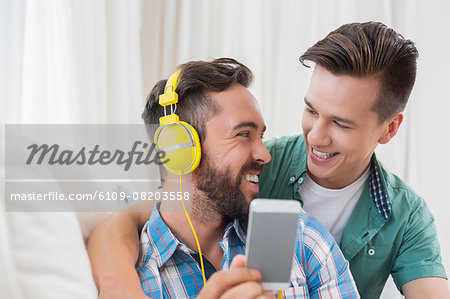 Homosexual couple men listening to music Stock Photo - Premium Royalty-Free, Image code: 6109-08203558