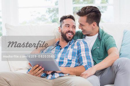 Homosexual couple men looking each other Stock Photo - Premium Royalty-Free, Image code: 6109-08203565