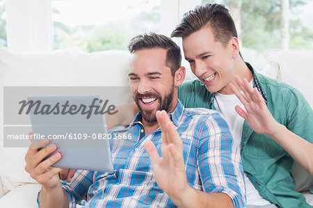 Homosexual couple men gesturing greeting Stock Photo - Premium Royalty-Free, Image code: 6109-08203566