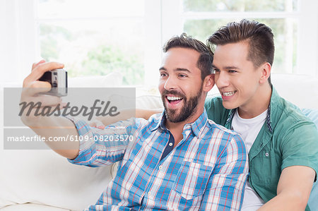 Homosexual couple men taking a selfie Stock Photo - Premium Royalty-Free, Image code: 6109-08203570