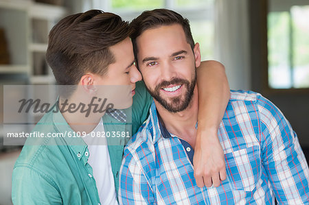 Homosexual couple men with arms around Stock Photo - Premium Royalty-Free, Image code: 6109-08203581