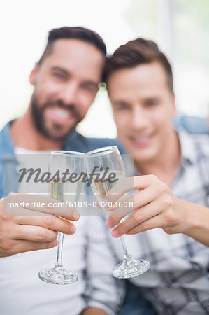 Homosexual couple men toasting with a champagne flute Stock Photo - Premium Royalty-Free, Image code: 6109-08203608