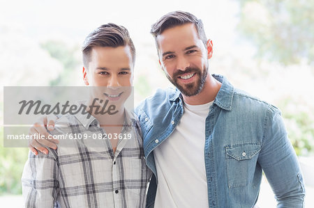 Homosexual couple men looking at the camera Stock Photo - Premium Royalty-Free, Image code: 6109-08203619