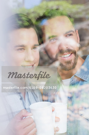 Happy homosexual couple looking through the windows Stock Photo - Premium Royalty-Free, Image code: 6109-08203630